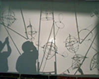 Shadow puppet performance set to music from a family workshop